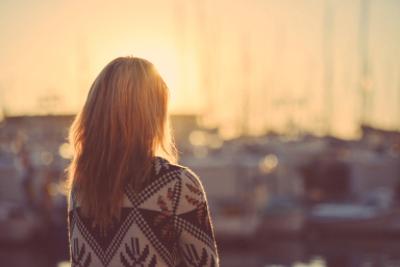 girl watching sunset_unsplash