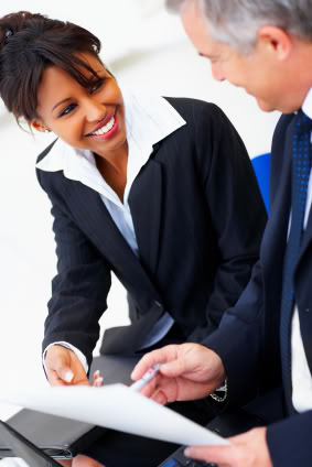 Businesswoman smiling with a businessman