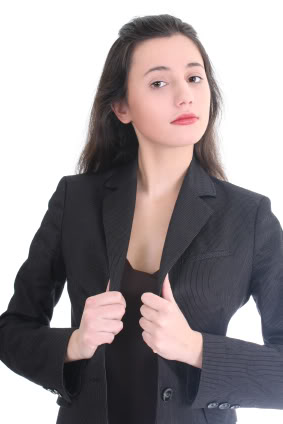 Young Businesswoman Correcting Her Suit